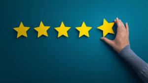 Business woman pointing five star to increase the rating, Consumer feedback, panorama, copy space
